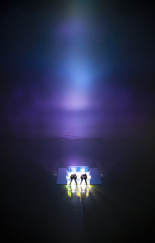 Dichroic Ripple, 2015. Installation with fan, flashlights, water filled ovenware and dichroic glass.